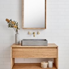 White tile wall, natural wood vanity with concrete floating sink, brass knobs, rectangular brass framed mirror. Minimalist Bathroom Furniture, Modern Bathroom, Small Bathroom, Master Bathroom, Bathroom Ideas, Neutral Bathroom, Bathroom Designs, Mirror Bathroom, Basement Bathroom