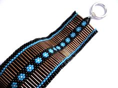 Peyote Bracelet in Turquoise Blue and Brown Beaded Cuff Beadwoven Handmade Seed Beads. $38.00, via Etsy.