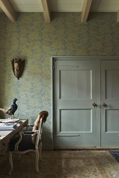 Office with doors in Blue Gray and wall in Farrow & Ball Versailles BP2614 wallpaper pattern.