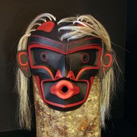 Dzunukwa Mask Stanley Clifford Hunt  Dzunukwa Mask carved from red cedar and detailed with paint and horse hair.