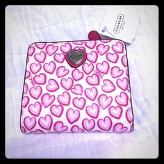 Coach small heart wallet Brand new with tags Coach wallet. Smaller in size. Perfect for traveling or someone who doesn't carry everything like I do. Hehe Never used. White with pink hearts on front and back. All pink interior. F50776 Coach Bags Wallets