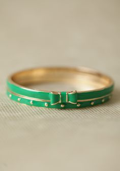 Waldorf Bow Bangle Set 18.99 at shopruche.com. Add a vibrant touch of color to your look with this set of two gold-toned bangles with kelly green enameling. One bracelet features tiny gold-toned studs, and the other is perfected with a dainty bow pendant.2.75