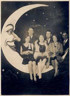 Paper moon photo, such a cute idea for a group photo. Probably a prom picture, oh so retro!