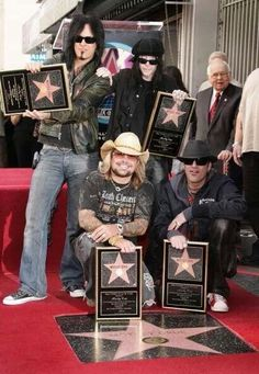 Motley Crue!! Just started reading their memoirs...hahaha, I admire them just for still being alive