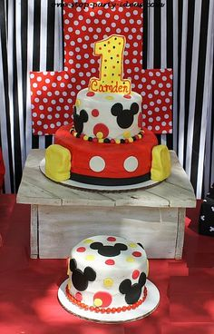 Mickey Mouse birthday cake and smash cake display.  See more Mickey Mouse birthday and party ideas at www.one-stop-party-ideas.com