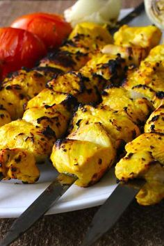 Joojeh kabob is a Persian kebab prepared with juicy pieces of chicken marinated in lemon juice as well as saffron and finely chopped onion. Persian Chicken Kabob Recipe, Iranian Chicken Recipe, Chicken Kabob Recipes, Kebab Recipes, Chicken Kabobs, Middle East Food, Middle Eastern Recipes, Kefta Kabob Recipe, Recipes