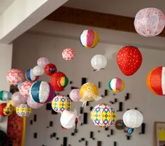 hanging inflatable paper balls. Makes for a fun decor idea for a party or intimate wedding reception.