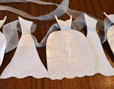 Wedding Dress Garland Paper Bridal Shower Decoration Sparkly White and Light Blue. $18.00, via Etsy.