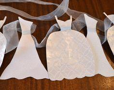 Wedding Dress Garland Paper Bridal Shower Decoration Sparkly White and Light Blue. $18.00, via Etsy.
