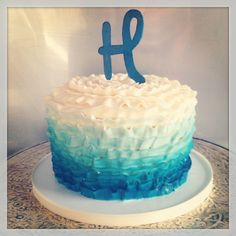Buttercream baby shower cake with navy blue to white ombre ruffles.
