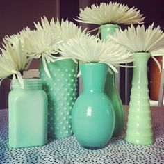 Inside of glass vases painted different shades of the same color. Love.