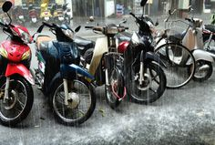 Sudden September rainfall in the heart of Hanoi, Northern Vietnam. The normally chaotic streets of Hanoi seemingly abandoned
