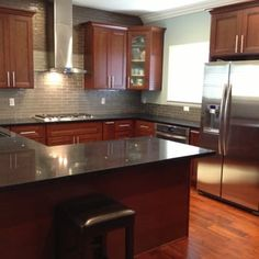kitchen cabinets - american cherry, glass subway tile backsplash
