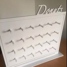 Donut Text Wall Hire only £30  — Donut Text Wall Donut Wall, 80cm x 67cm Wall With Donut Text on the top Holds 24 and 48 Donuts Comes with double donut pegs 24 of each  Made from 10mm food grade plastic The Cost of hire is £30  A refundable deposit is also needed, which is paid on collection and shall be refunded when the wall is returned.  Free Donut Wall Sign Hire with every Booking 