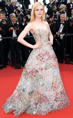 "ELLE FANNING does it again in a Dior Haute Couture sage green tulle bustier dress with ""impressionist garden-effect feather embroidery. She also wears a Dior Fine Jewelry "" Cygne Blanc"" ring in white gold, diamonds and rubies to the Cannes 70th Anniversary Celebration."