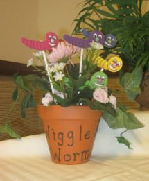 Wiggle Worms songs.  When the children are wiggly, have one come and choose a wiggle worm with a wiggle song written on it.  Cute.