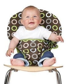 Clever .... Turn any chair into a baby seat!  Hooks over the back & folds up around your baby's tummy.  (This would be soooo helpful for traveling)