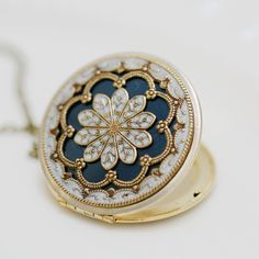 ON SALE Locket,blue locket,filigree locket ,resin locket,Bridal Necklace ,bridesmaid gift ,Wedding Necklace,Something Blue,Vintage Locket. $62.99, via Etsy.