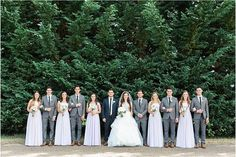 Bridal party in lilac dresses and dark gray suits @myweddingdotcom