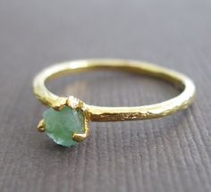 raw emerald ring.
