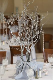 inexpensive centerpieces. Would be pretty with the candle light shining up through the branches.
