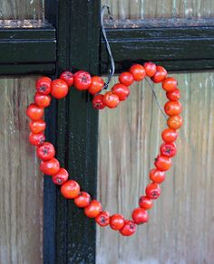 Make a heart wreath with rosehips or rowan berries