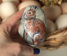 Natural stone ornamented with a hand-painted hare-Lepus europaeus. Latin name painted.  Natural stone picked up by me on beautiful greek beach, fixed