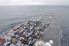 The aircraft carrier USS Ronald Reagan transports Sailors' vehicles (Jan. 9, 2012)