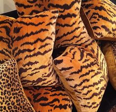 Glowing Gold! Our Scalamandre Tiger Silk Velvet and Clarence House Gold Leopard Pillows.