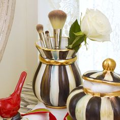 Say goodbye to boring, basic cosmetic storage and upgrade to the ceramic Courtly Stripe Brush Jar. Our goes-with-everything color-dragged stripes, gilded with bands of gold lustre, elevate your vanity, and provide a fittingly beautiful spot for your favorite makeup brushes. Enjoy a bit of everyday luxury!