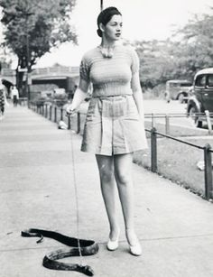 A woman takes her pet snake out for a slither | Community Post: 30 Strange But Delightful Vintage Photos Of Animals