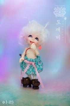 Fairyland sneakiness!  A new RealPuki named Ara.  Want, want, want.