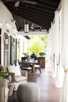 Porch living in a southern lakefront dream home designed by Heather Garret