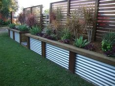 Raised flower beds would look great long our walkout walls!! Fence Designs by scenic scapes landscaping. The taller fence a little shorter. Match colorbond to roof. by roxanne