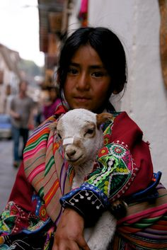 Girl with the damaged lamb - Cusco, Cusco The little lamb has a boo boo MW! See the bandaid on his nose?? The girl and the lamb live far away, in South America....