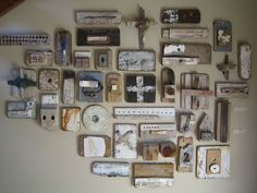 Ngaio Lenz --An artist displays his found object art on wall.