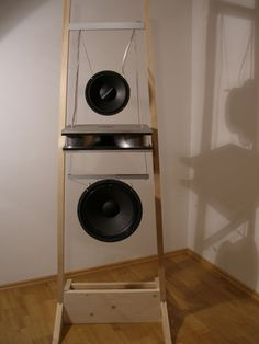 "going ""nude"" – meaning hanging the speakers without any baffle at all."