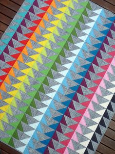 love rainbow quilts and this flying geese version is particularly beautiful!