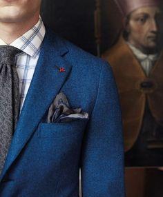 Blue jacket, white shirt with blue windowpane plaid, grey tie