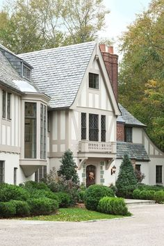 In renovating this American Tudor Arts & Crafts home, we were also mindful of how to apply landscaping to frame the architecture American GothicTudor Garden Grounds Porch by Wadia Associates Tudor Exterior Paint, Tudor House Exterior, Exterior Paint Colors For House, Paint Colors For Home, Exterior Design, Paint Colours, Exterior Colors, Style At Home, Maison Tudor