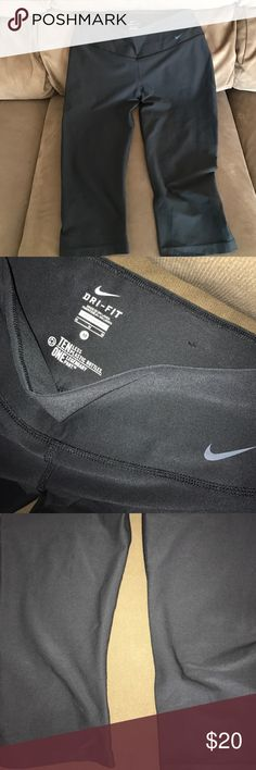 Nike Dri Fit Crops Size Medium Excellent condition. No piling or snags. Fits true to size. A little loose in the legs. Ten less plastic bottles version. Great quality. Lowest offer is the price listed. No trades or Mercari. Price firm unless bundled. They are black Nike Pants Track Pants & Joggers