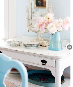 Chippy white desk, aqua blue, and soft pink accents!
