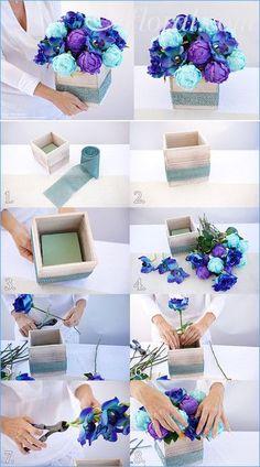 Blue Wedding Design Ideas for the DIY Bride. Silk flowers into whitewash planter accented with aqua rhinestones