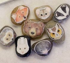 Story rocks for The Mitten. Go to Jan Brett's site and print the masks and hot glue onto river rocks.
