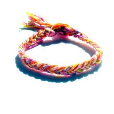 Matierals: all you need is string ( yarn will work too )  1.Choose three colors. 2. Cut three strands of each color ( 12 inches long) 3. Tie all the colors together in a knot 4, Separate them into three strands with three strands in each. 5. Braid Away! 6. Tie it around your wrist 7. Your Done!