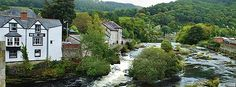 LOOKING UP THE RIVER DEE IN LLANGOLLEN AT THE RAPIDS A CANOEIST RUN