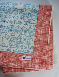Baby Blanket with Cars in Blue and Red Summersville and Cream Minky. $42.00, via Etsy. CUTE!