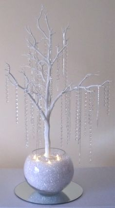 HIRE PRICE INCLUDES:    ARTIFICIAL 90CM MANZANITA TREE  (THE CENTREPIECE WITH THE BOWL IS APPROX. 1.10M)  CRYSTAL & DIAMANTE STRANDS HANGING FROM THE BRANCHES  LARGE GLASS BOWL APPROXIMATELY 30 X 24 CM  ACRYLIC CLEAR STONES IN THE BASE OF THE BOWL  6 X LED TEA LIGHT CANDLES IN THE TOP OF THE STONES  A 40CM MIRRORED BASE    £35.00