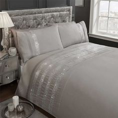This cotton blend duvet comforter cover features silver diamante sequin bands with pintuck detailing, which run across the top of the duvet comforter cover, on a plain background. Finished with matching pillowcases and machine washable, this duvet comforter cover would add a touch of luxury to any themed bedroom. | eBay!
