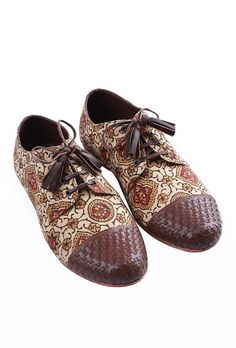 Brown hand-block printed Ajrakh fabric oxford in genuine goat leather with leather weaving on toe cap and an inner lining of faux leather Comes with a pair of geuine leather laces with tassels and genuine buffalo leather sole Perfectly designed to be paired with any casual/formal outfit, these are comfortable pair of shoes that can be worn with traditional Indian as well as western silhouettes. Fabric used for these is hand-block printed in natural vegetable dyes: Ajrakh printing from Bhuj